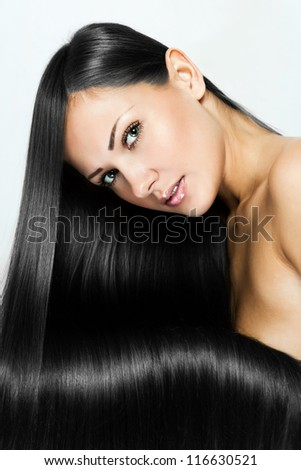 black hair , beautiful brunette woman with long natural hair , hairstyle.