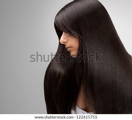 Black Hair. Portrait of Beautiful Woman with Long Hair. Good quality retouching. - stock photo