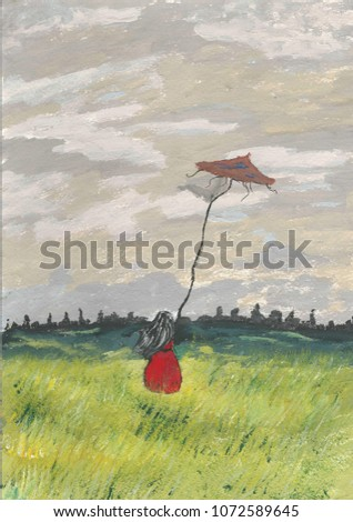 Stock Photo black haired girl in a field with a kite