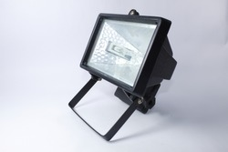 Black halogen light searchlight with white background