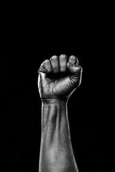 Black hand showing fist
