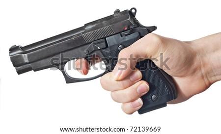 Black handgun in hand of a yong man.