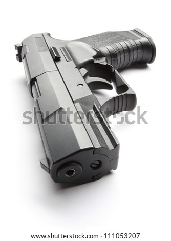 Black handgun isolated on a white background