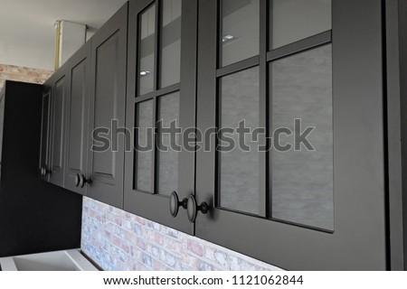Black handles vintage style on black kitchen wooden cabinets
