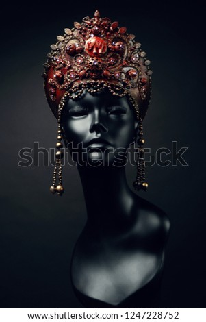 Black head of mannequin in creative in red  headwear