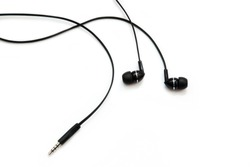 Black headphones for listening to music and sound on portable devices: music player, smartphone, laptop and jack for connection on a white background. Ear plugs.
