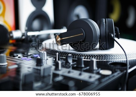 Black headphones for professional disc jockey.Dj play music,listen new tracks in high quality.Headset with powerful bass .audio equipment for sound recording studio.Remix techno musical compositions
