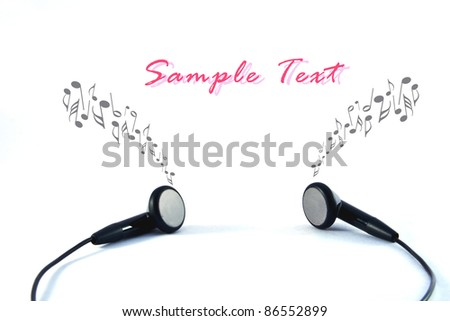 Black headphones with wires on white background - stock photo