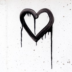 Black heart on white wall