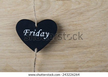 Black heart on wooden background. Valentine\'s Day, love, heart, feelings, gift, wedding, holiday, black Friday