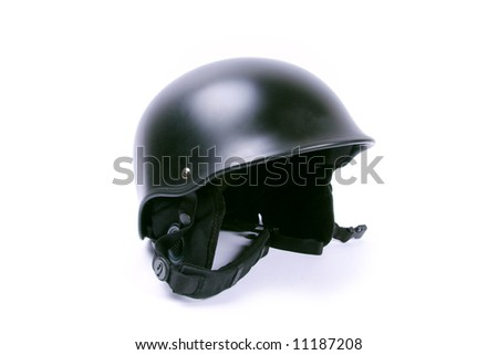 Black helmet with chin strap isolated on white.