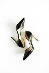 Black high heel shoes on white background. Flat lay, top view.