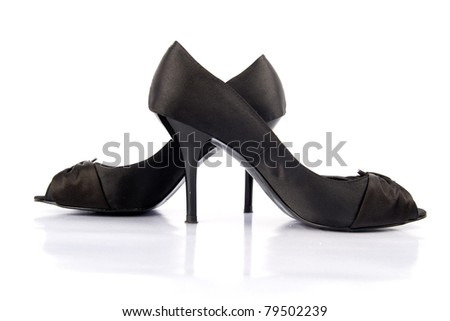 Black high heel women shoes on white background.