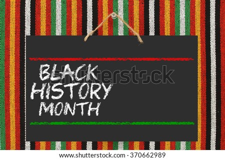 Black History Month Blackboard hanging on striped background #370662989