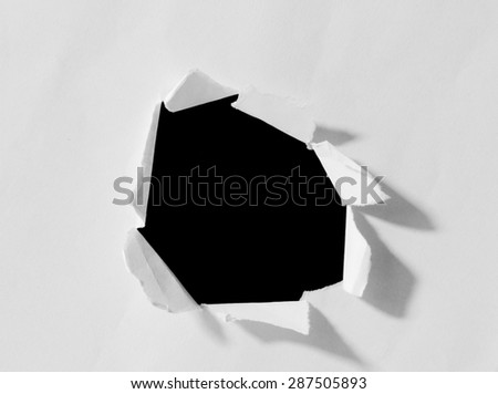 Black hole in white paper.