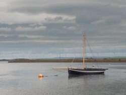 Black hooker trade wooden boat in Galway bay, Concept tradition, vintage, history. craft,