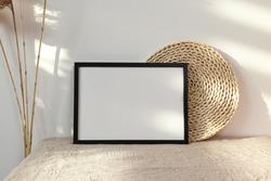 Black horizontal frame with dry cane