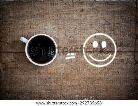 black hot fresh coffee espresso in white cup, equal sign and smile on vintage grunge wooden background