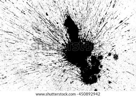 Photo of  Black ink splash on white background