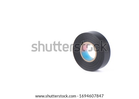 Black insulating tape to insulate twisted of electrical wires. Insulating tape isolated on white background. Copy space.
