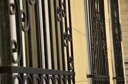 Black iron bars for protection on windows