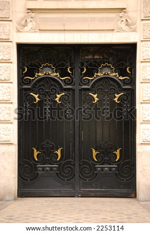 Black iron doors in old building in Paris France