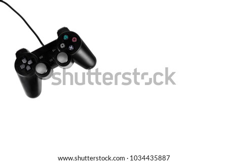 Black joystick on white background. Entertainment and video games. GamePad isolated on white - Shutterstock ID 1034435887