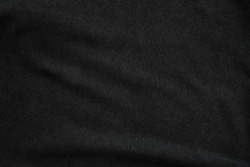Black jumper fabric close up