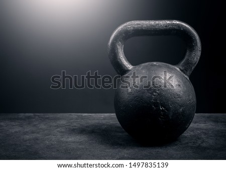 Black kettlebell on a black background