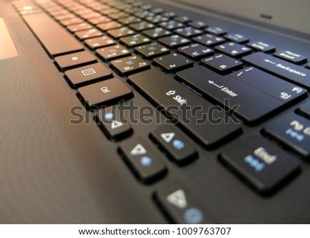black keyboard blurred background. business or office background.