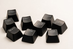 black keyboard buttons with white inscriptions on a white background close up