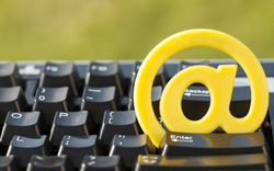 Black keyboard with yellow sign at