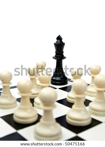 black king in the corner surrounded with the white pawns which can suggest victory of ordinary people over the bad leader, rebellion,revolution or riot.., focus on the king