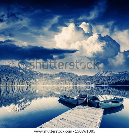 Black lake in Durmitor national park in Montenegro. Dramatic overcast sky. Balkans, Europe. Beauty world.