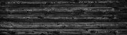Black larch grain wood wide panoramic texture. Widescreen wooden plank pattern backdrop. Dark rural background