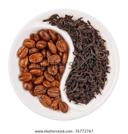 Black leaf tea versus coffee beans in Yin Yang shaped plate, isolated on white