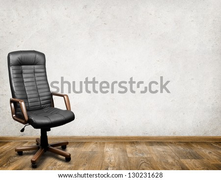 Black leather armchair in room. Business interior background #130231628