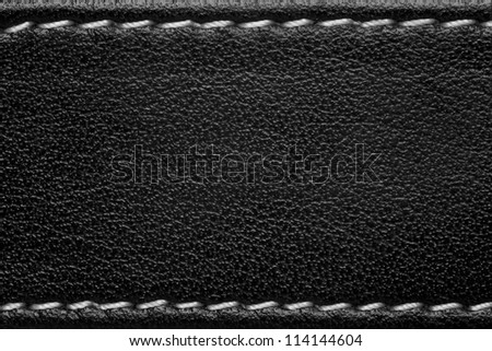 black leather background with white thread seam