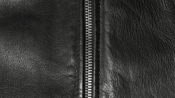 Black leather background with zipper.