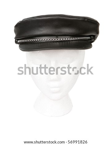 Black leather biker hat with silver chain resting on a head for proper perspective. Isolated with a clipping path