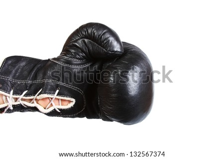 Black leather boxer glove punching from the left isolated on white background