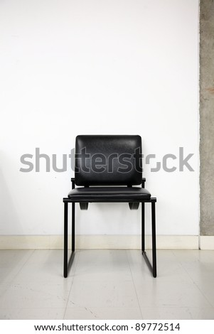 black leather chair over wall