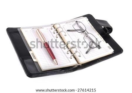 Black leather desk calendar isolated on white