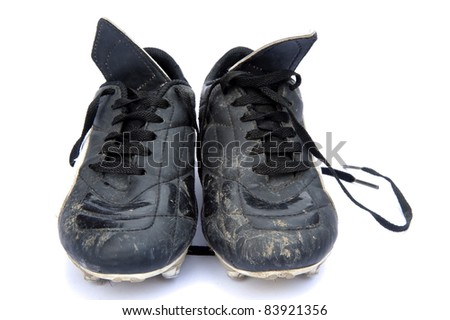 Black leather football soccer boots isolated on white background