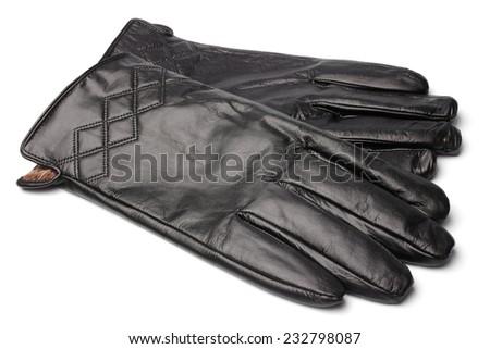Black leather gloves on white background