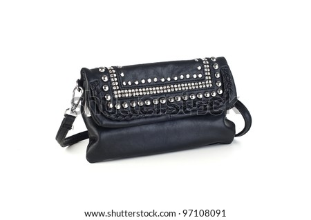 Black leather handbag with silver metal studs, jewels, and strap, white background
