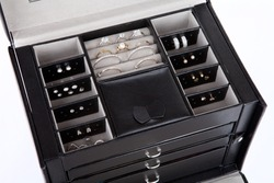 Black leather jewelery box with jewelry inside