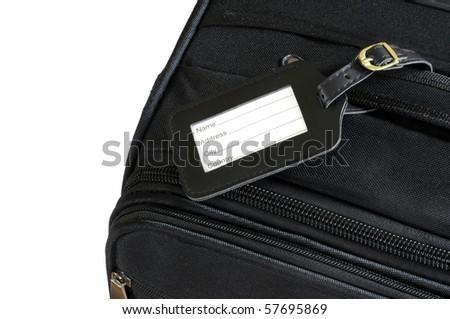 black leather label on a black suitcase