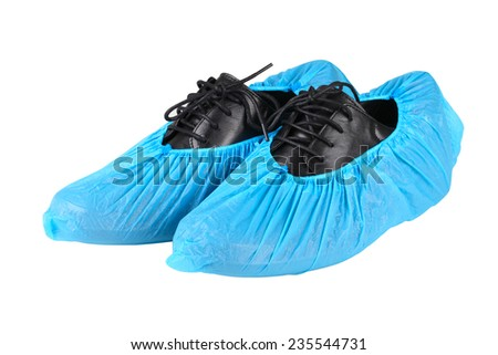 black leather mens shoes in overshoes isolated on white background #235544731
