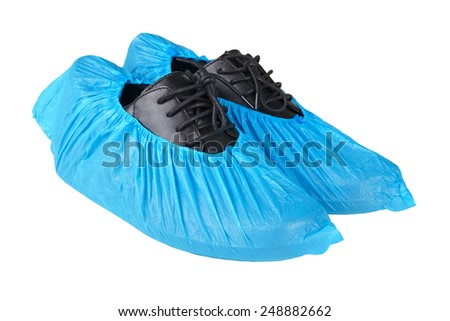black leather mens shoes in overshoes isolated on white background #248882662